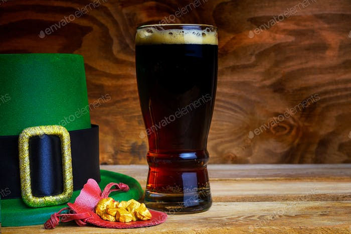 Saint Patrick day symbols green hat and leprechaun gold