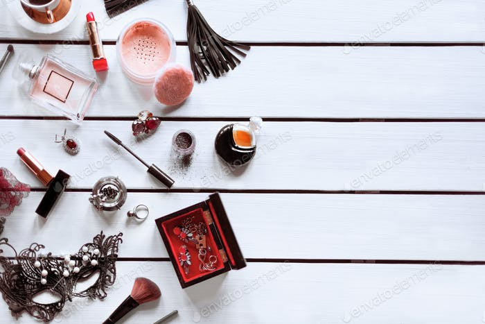 Female cosmetic, perfume and accessories on a white background
