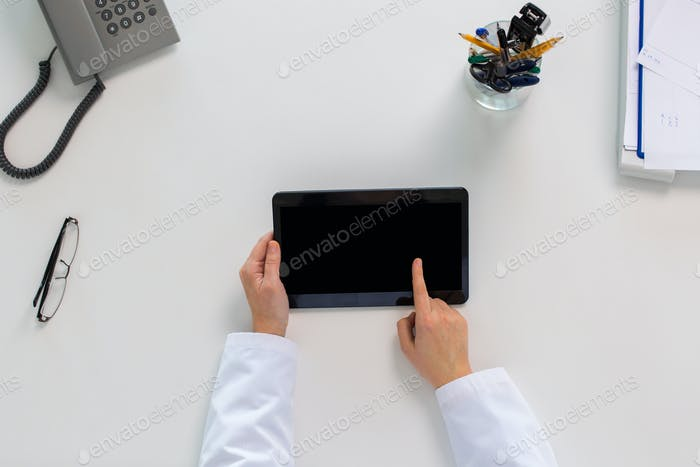 doctor hands with tablet pc at clinic