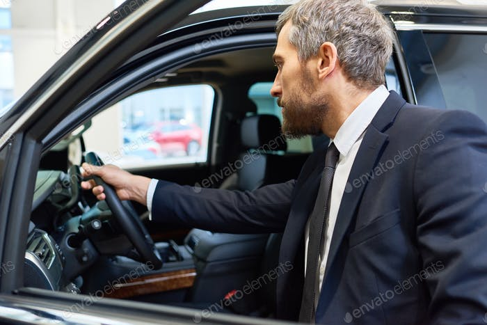 Mature Man Choosing Car for Rent
