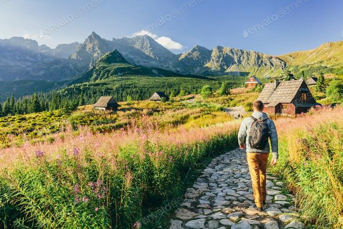Man walking on hiking trail in Tatra mountains in Poland