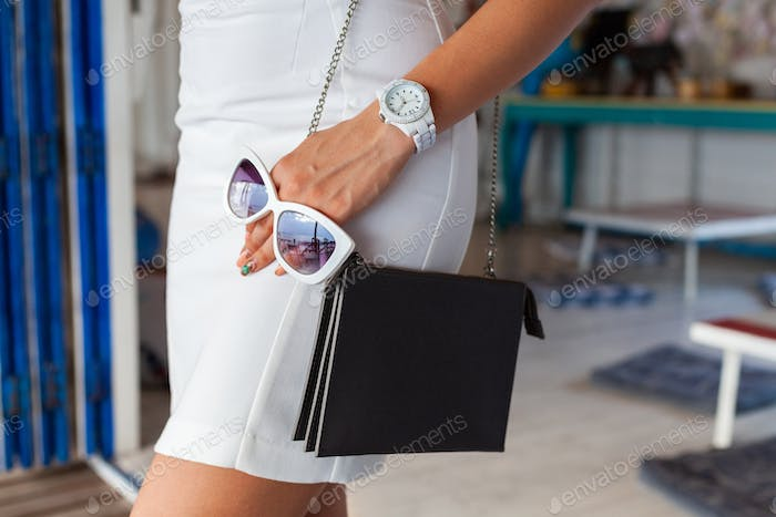 stylish woman accessories bag, sunglasses and watch
