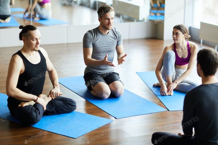 Young man asking question at yoga seminar
