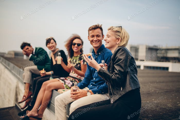 Young people partying on terrace