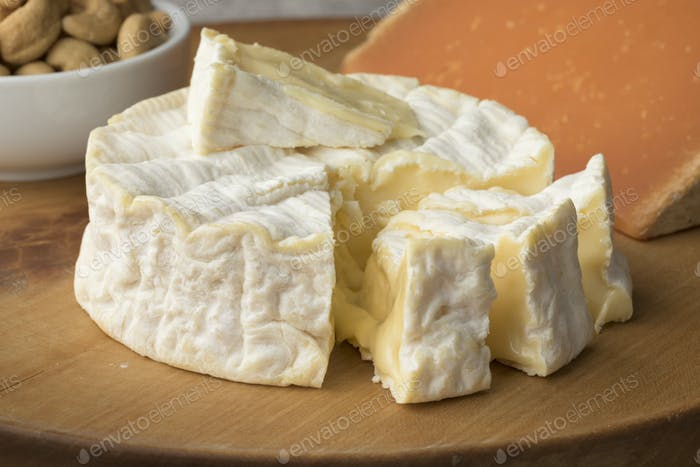 French Camembert cheese on a cutting board