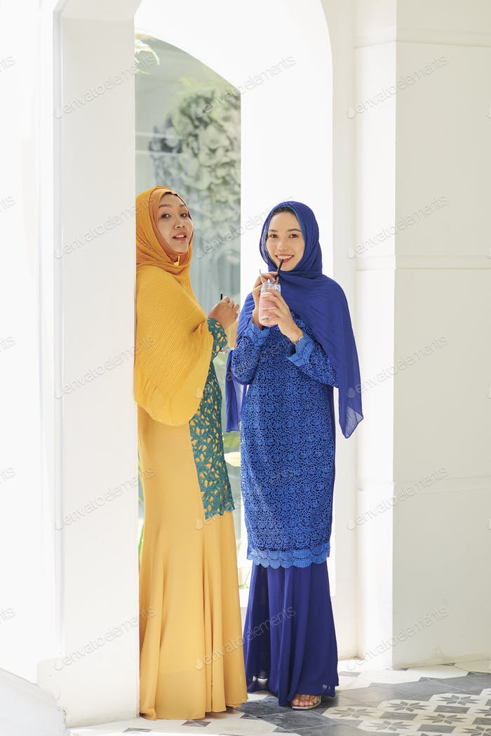 Asian women in traditional muslim dresses
