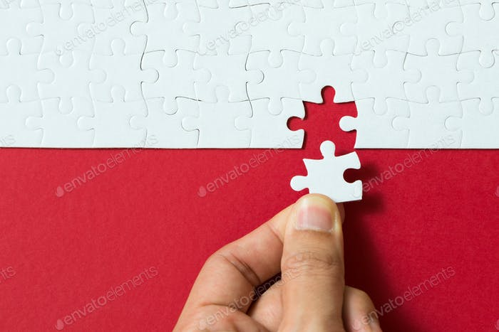 Red background made from jigsaw puzzle