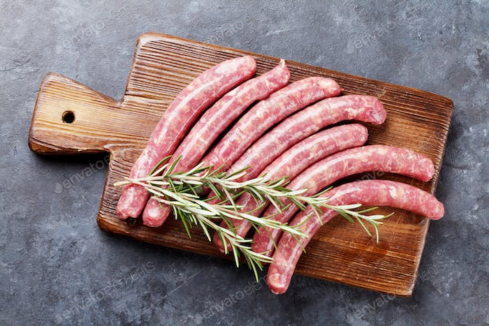 Raw sausages and ingredients for cooking