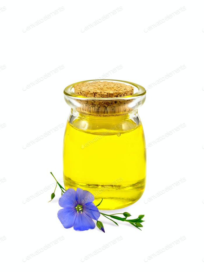 Oil linenseed in jar with flower