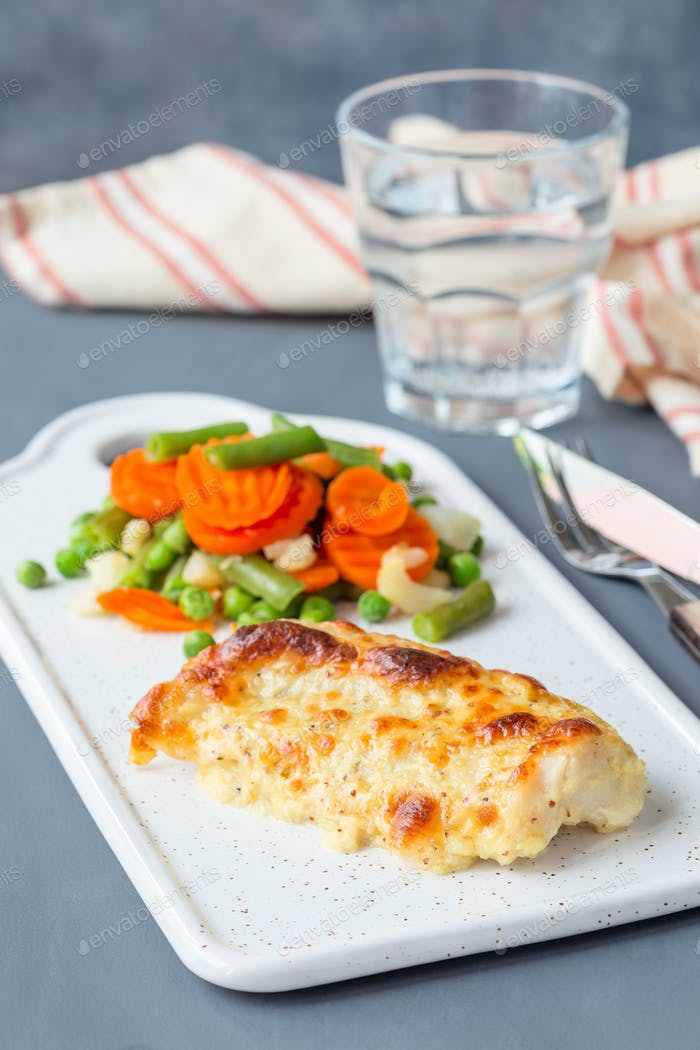 Baked cod fish fillet under cheese, mustard, pepper and cream cr