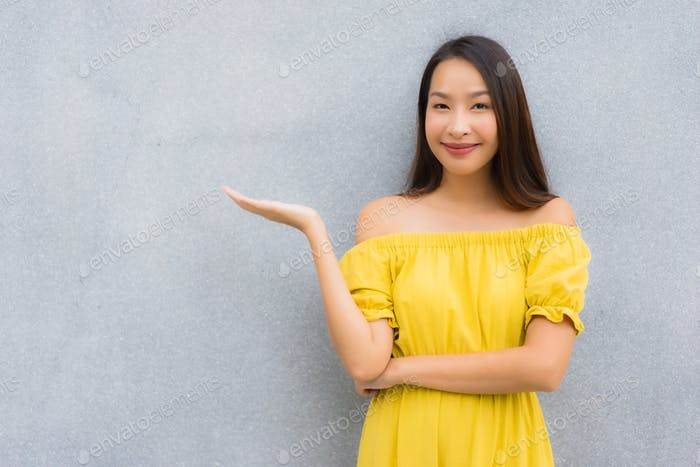 Portrait beautiful asian women smile happy with concrete backgro