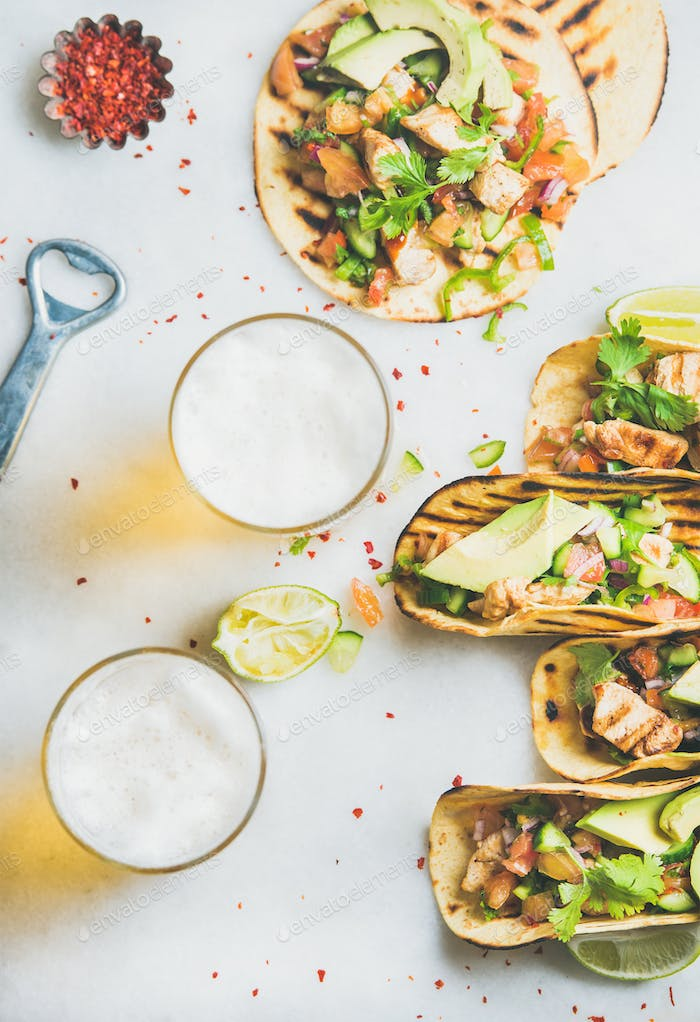 Healthy corn tortillas with chicken, vegetables and beer in glasses