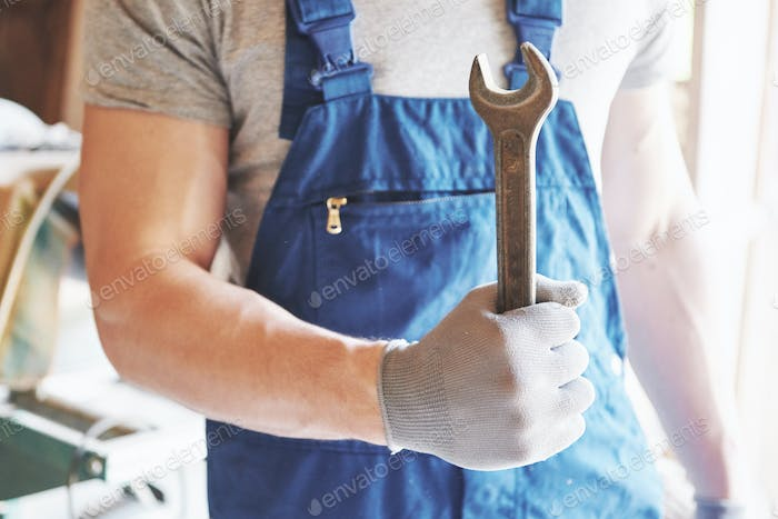 Master in working form and gloves with a key in his hands