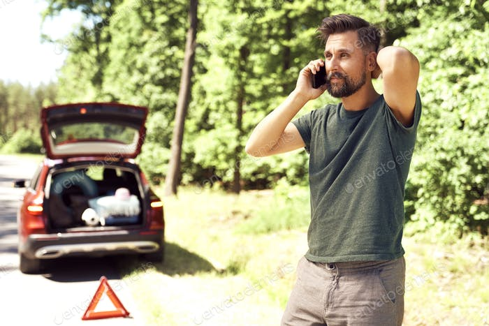 Man calling for help on the road
