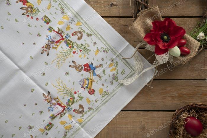 Easter tablecloth with a decorative wreath and a basket