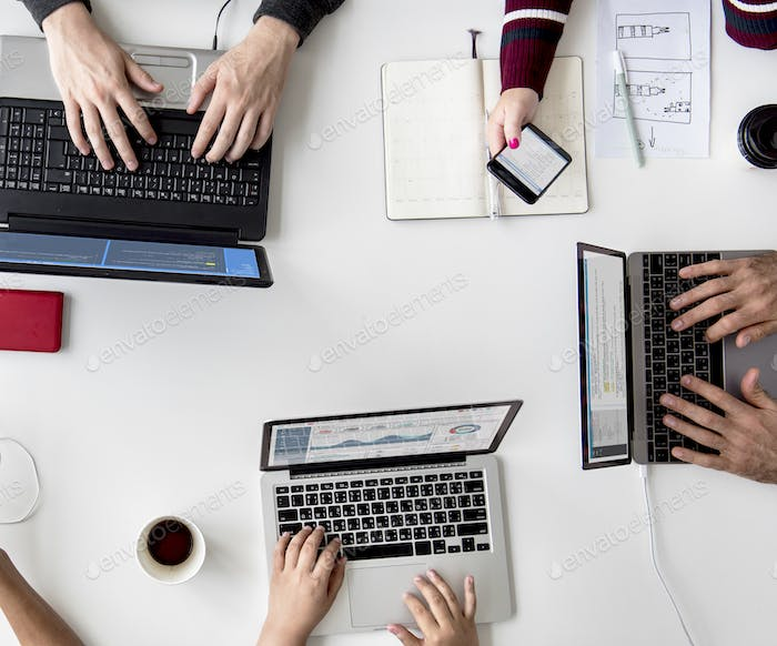People Hands Working Using Laptop on White Table