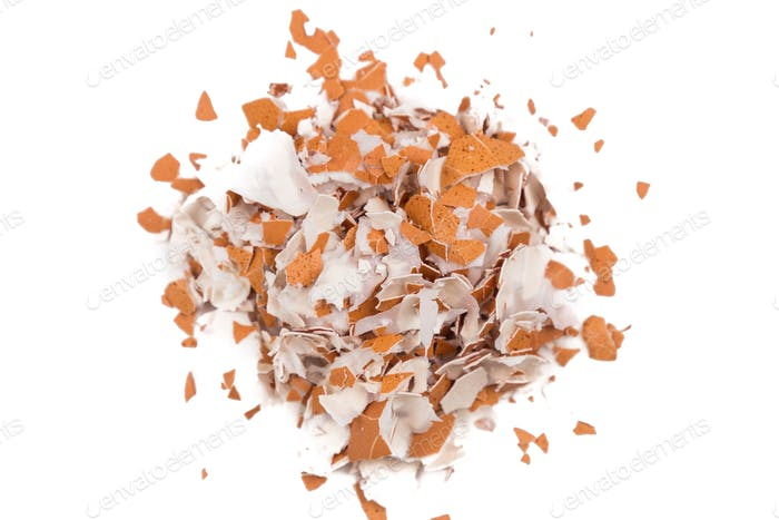 Pile of crushed egg shell on white background