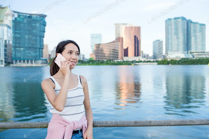 Woman talk to cellphone in Macao city