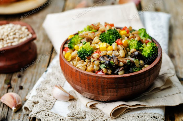 barley porridge with corn, broccoli, garlic, mushrooms and peppe
