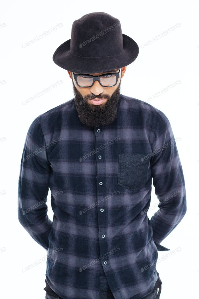 Handsome bearded african man in black hat and glasses