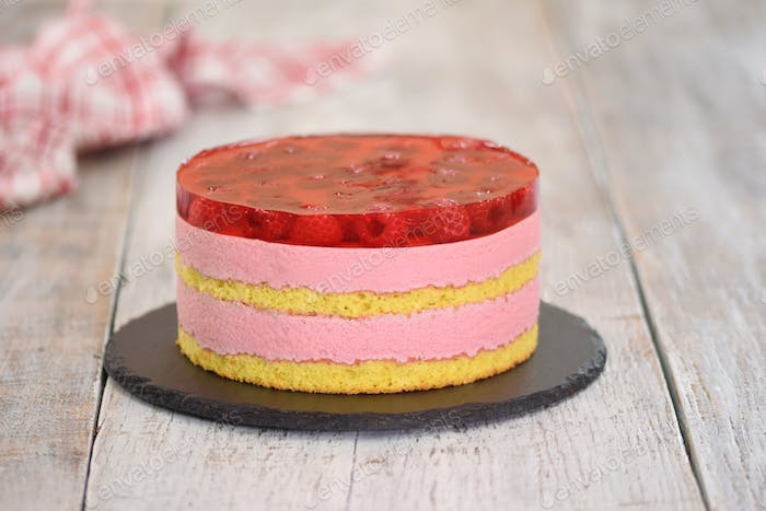 Raspberry mousse cake. Cake with jelly and cream. Cake with raspberries.