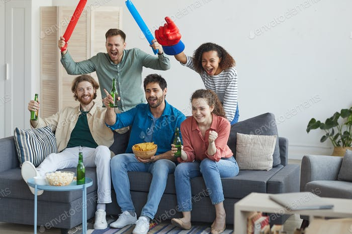 Multi-Ethnic Group of Friends Watching Sports on TV