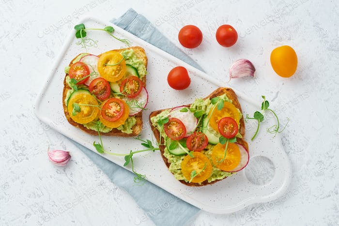 avocado toast with cherry tomatoes and herbs, breakfast, top view