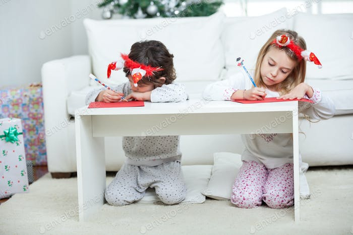 Children Writing Letter To Santa Claus During Christmas