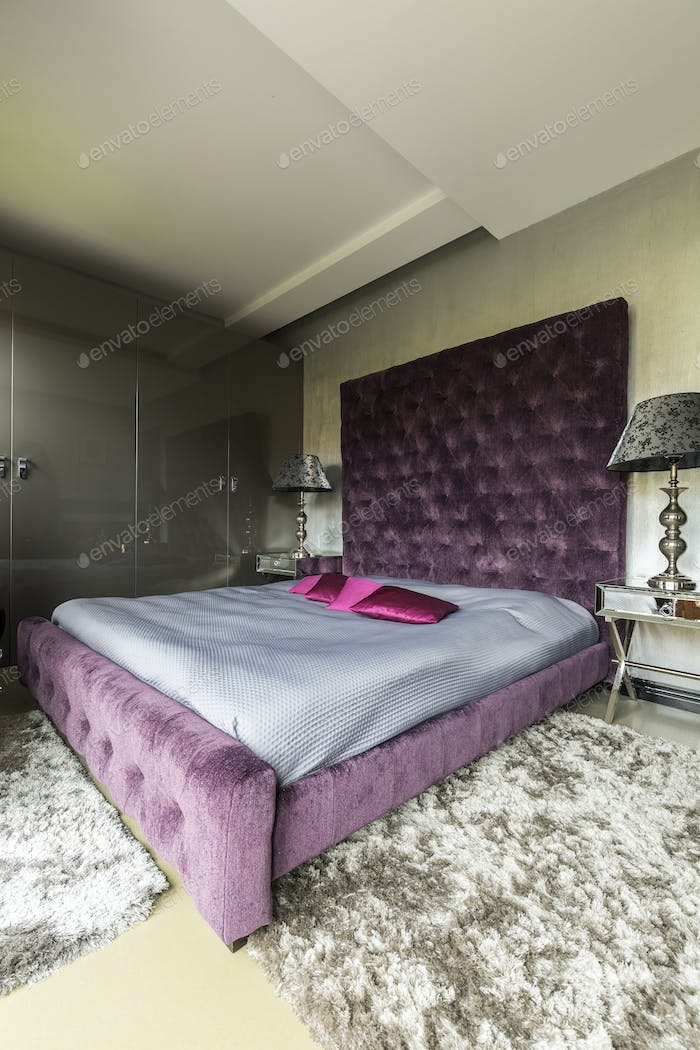 Luxurious bedroom with a violet king size bed