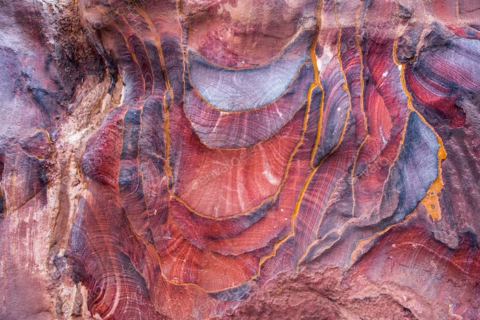 Red sandstone formation texture. Abstract geological pattern. Petra, Jordan