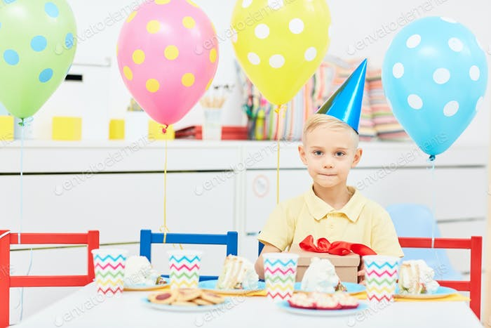 Boy by festive table