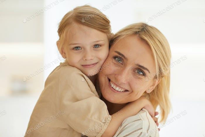 Happy Woman Holding Cute Little Girl