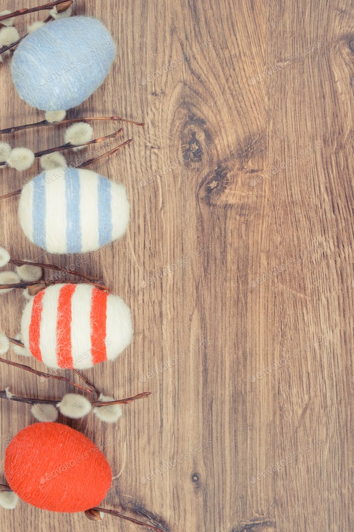 Easter catkins and eggs wrapped woolen string