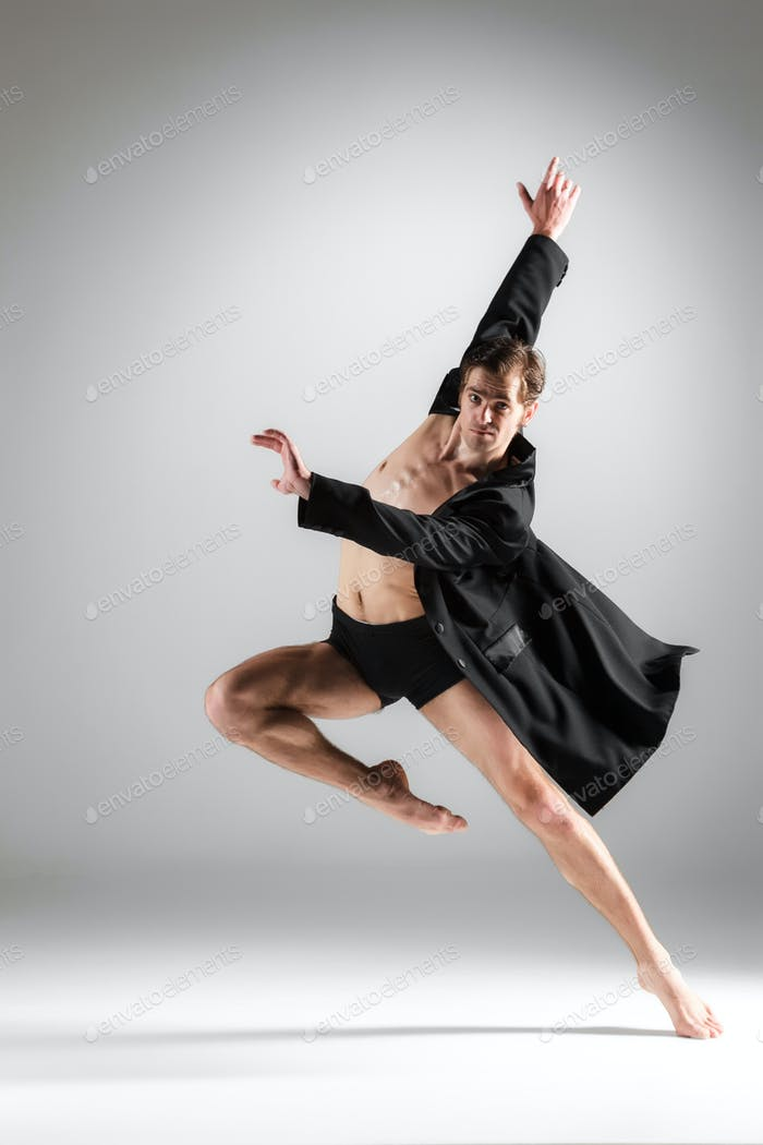 The young attractive modern ballet dancer on white background