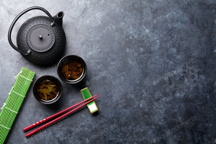 Green tea and sushi chopsticks. Japanese meal set