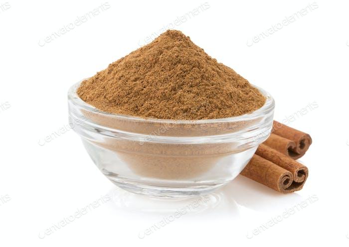 cinnamon in bowl on white
