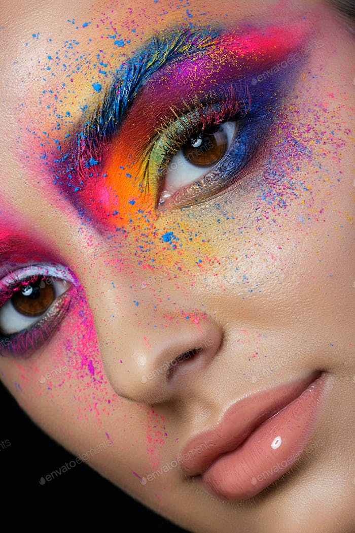 Close up view of female face with bright multicolored fashion ma
