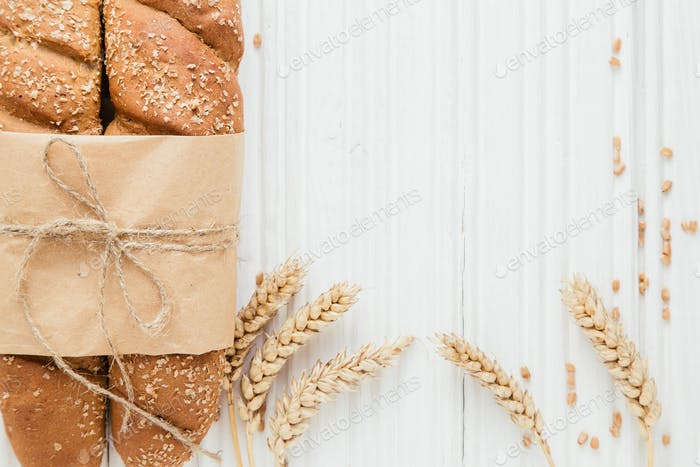 Two French baguettes with ear of wheat