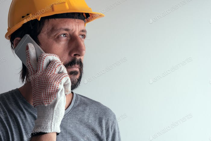 Construction engineer talking on mobile phone