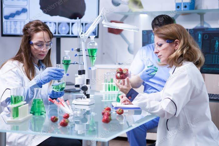 Team of caucasian scientist working together agriculture industry