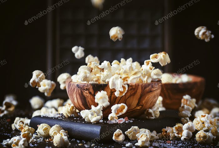 Salted popcorn in a wooden bowl