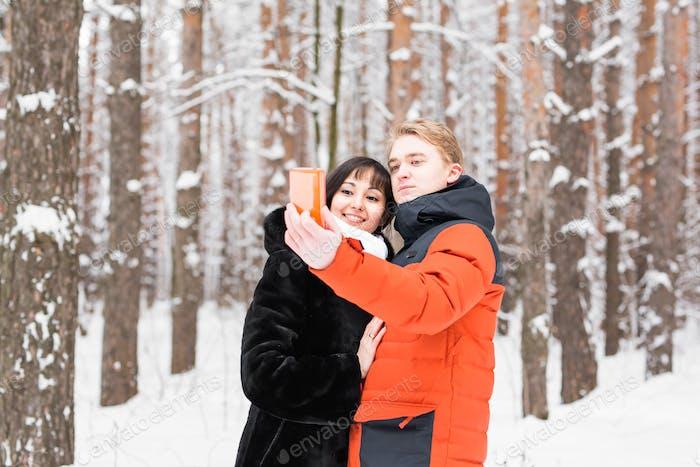 boyfriend girlfriend winter selfie on a walk