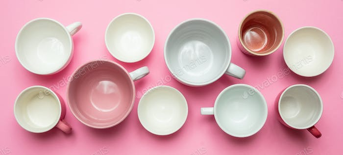 Empty coffee cups white and pink color against pink background, banner