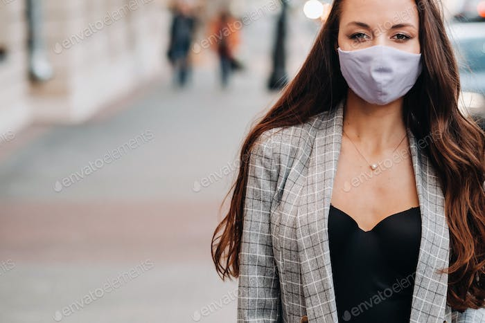 Covid-19 and Air pollution pm2.5 concept. Pandemic, portrait of a young woman wearing protective