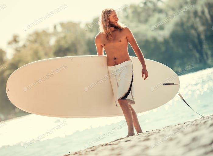 Man standup paddleboarding