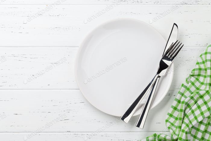 Empty plate with cutlery