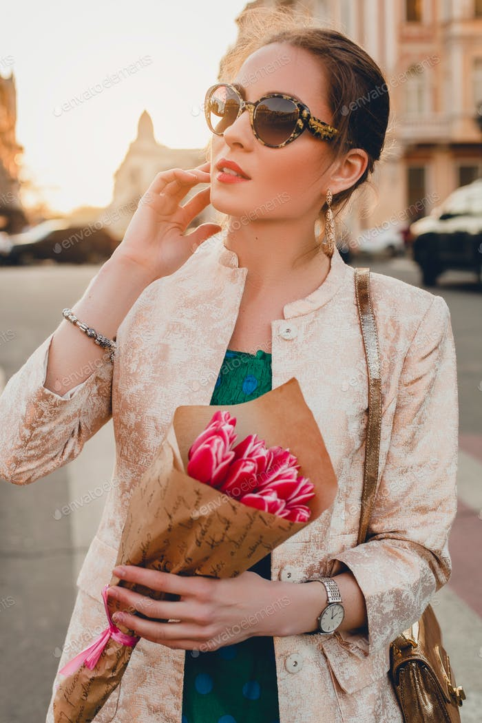 hands of stylish woman holding flowers bouquet