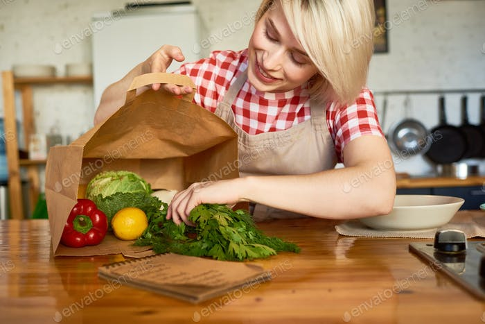 Pretty Housewife in Cozy Kitchen