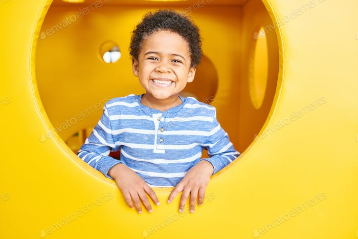 Happy Boy Playing in Play Area