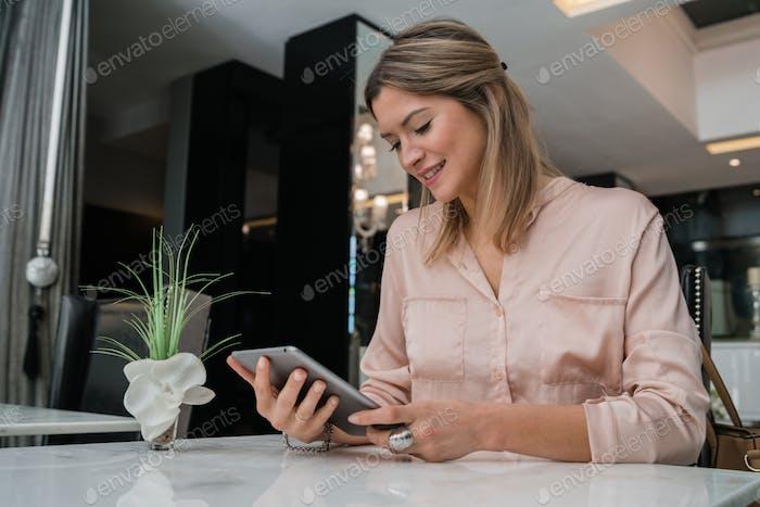 businesswoman working on her digital tablet.